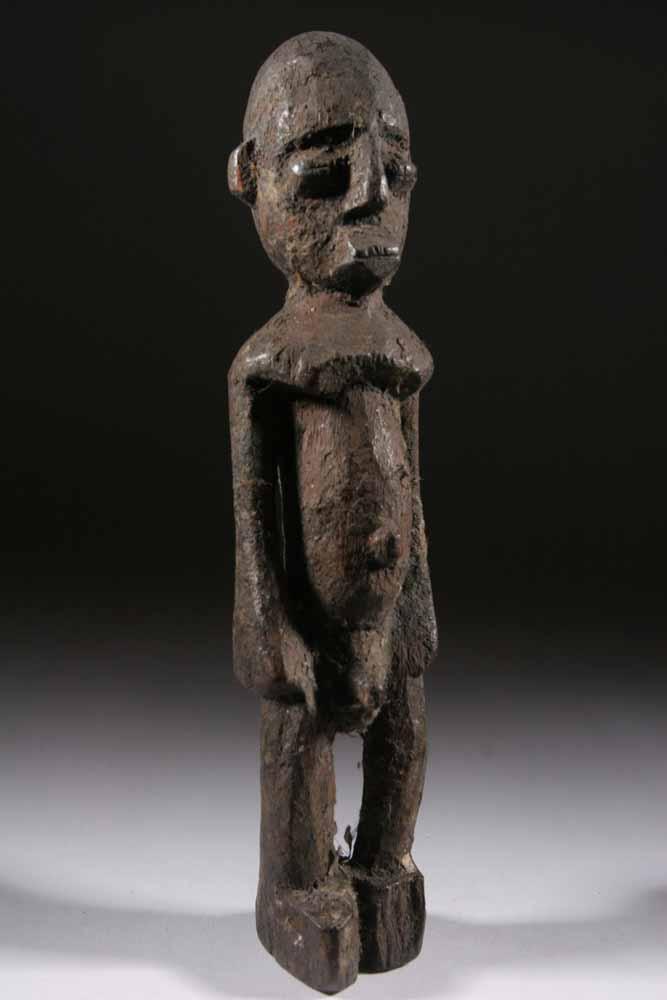Sculpture Africaine En Bois - La statue Lobi est un exemple de simplicité de l' art africain