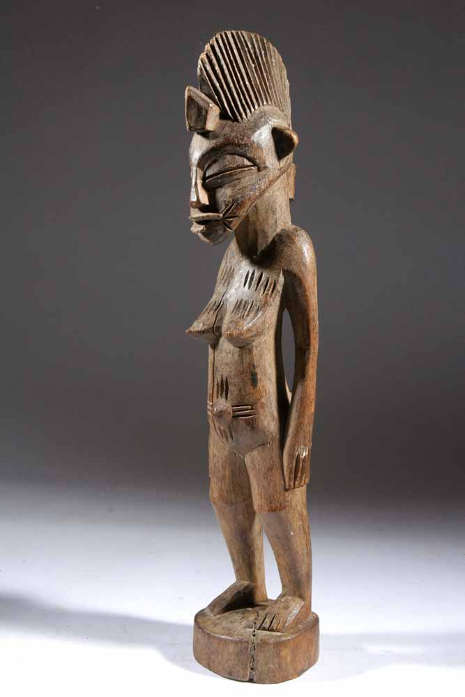 statue africaine filiforme
